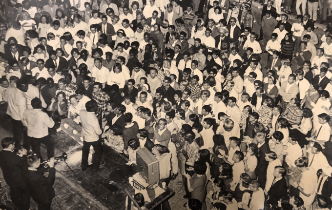 Hundreds of students in front of a stage at the UF Student Union